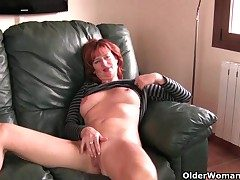 Redheaded full-grown nourisher plays with her nipples increased by pussy