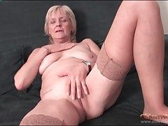 Granny strips close to stockings and fingers pussy