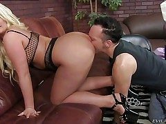 Julie Cash is a curvaceous blonde domina with enormous boobs