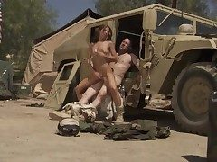 Soldier in uniform is pummeling a girl